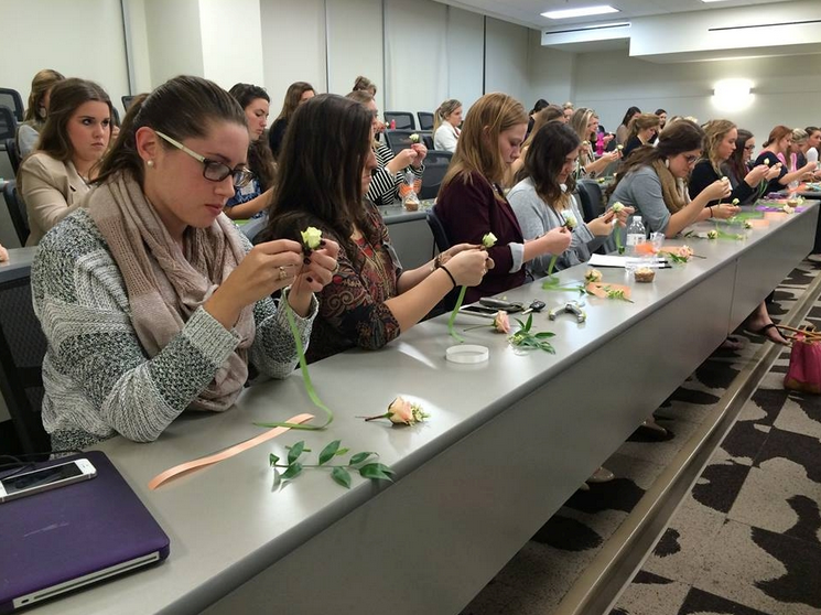 photo credit: SEPA - student members learning how to make boutonnieres